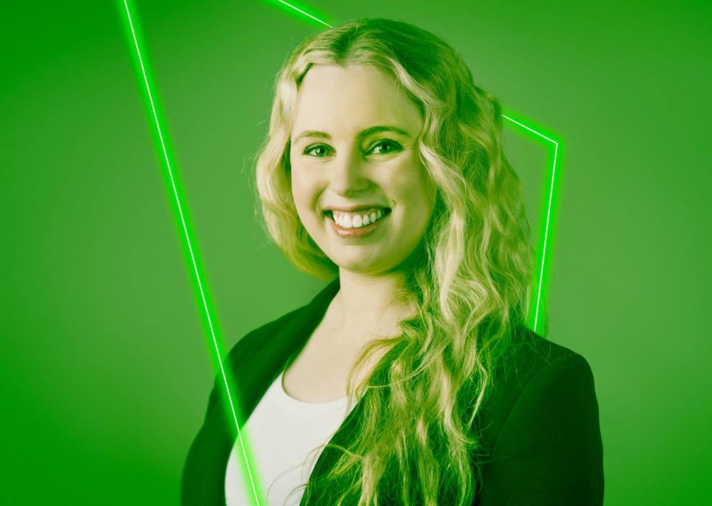 katie cook smiling headshot- green wash