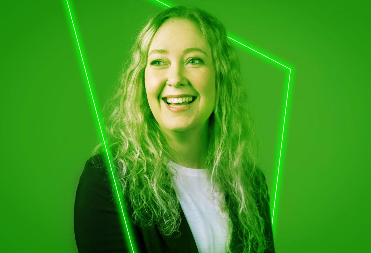 renee hope headshot looking away laughing green wash